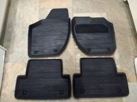 Set of four genuine Volvo V40 all weather fitted rubber mats in charcoal for current model