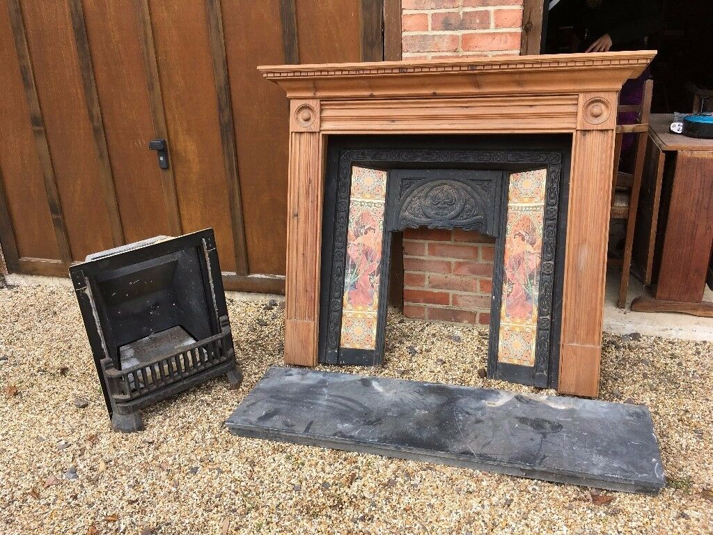 beautiful cast iron fireplace with antique meuba tiles in new