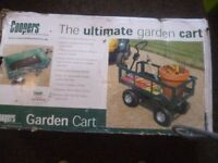Coopers Ultimate garden cart,never been out of the box,box battered because stored in garage