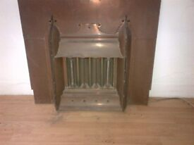 old vintage brass electric fire place or heater can deliver