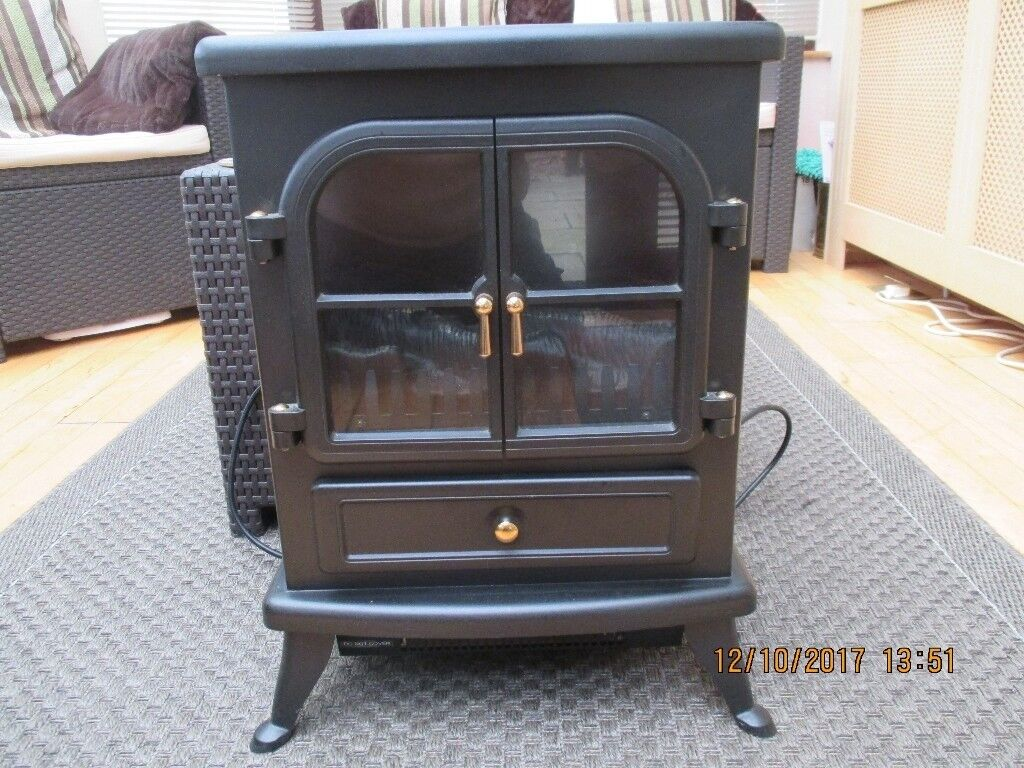 Stove type electric room heater