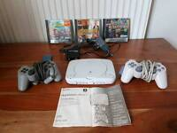 PS1 console with games