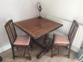 Solid oak, extendable dinning table with four chairs