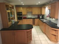 large kitchen in excellent condition. Complete with multiple appliances and ample storage