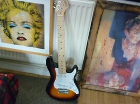 Fender shape guitar with amplifier and lead