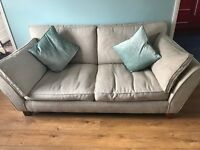 Cream and brown settee