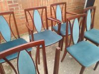 Drop-leaf dining table with 8 mahogany chairs