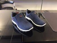 Blue slip on trainers,