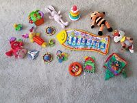 Job lot infant toys teething, soft books, musical, stacking. From smoke pet free home.
