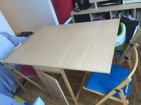 Selling folding table + 4 chairs