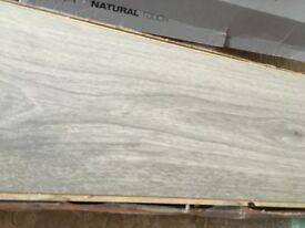 3 packs of grey laminate flooring