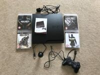 Sony PS3 + 4 games, handset, and bluetooth ear piece