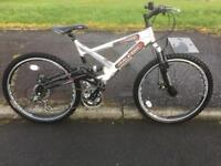"RALEIGH LITHIUM FULL SUSPENSION MOUNTAIN BIKE DISC BRAKES 26"" WHEELS NEAR MINT CONDITION."