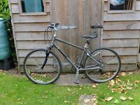 Giant Men's hybrid bicycle. (Cypress.) Medium. 3x7 gears.2 years old. Good condition.