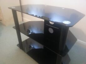 Black glass television stand. Good condition.
