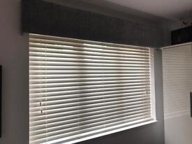 White wooden slat blinds