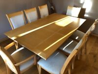 Maple extendable dining table with 8 chairs and matching cabinet