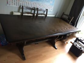 £200 Very large antique dining table and six chairs
