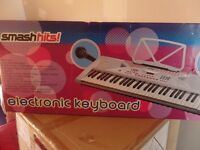 Brand New Smash Hits electronic keyboard with stand