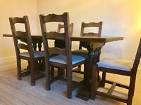 Solid teak dinning table and six chairs