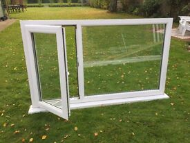 White UPVC window. large fixed pane and 1 opening pane with lock. 1800mm wide & 1065mm high inc sill