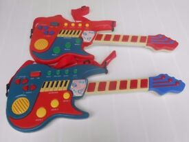 (268) Two Toy Electric Rock Guitars with Shoulder Straps