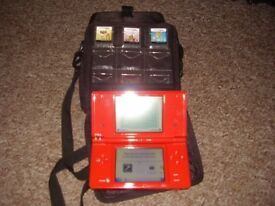 NINTENDO DSI WITH GAMES CASE AND CHARGER