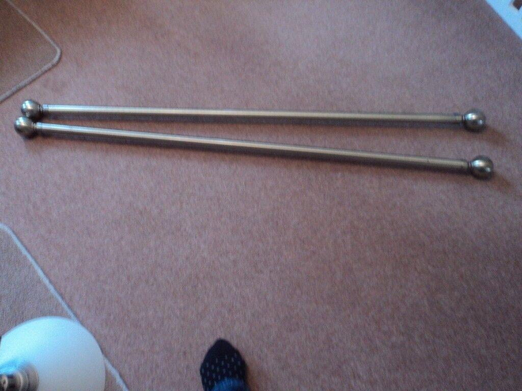 2 - metallic finish curtain rods