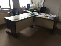 Various desks, tables and chairs