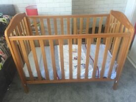 Cot-oak coloured with drop side
