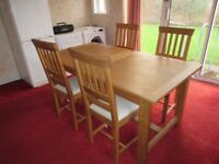 Oak dining table and chairs by Laura Ashley immaculate