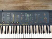 Yamaha keyboard PSR-70 (1985) with case and stand