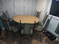 Round dining table and 6 chairs