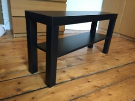 Black, wooden TV stand