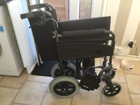 Folding wheelchair in excellent condition . Sturdy rubber tyres.