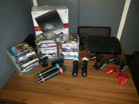 PS 3 PlayStation 3 console with 3 wireless controllers and 31 games