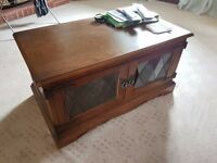 Coffee table for sale with a small glass missing