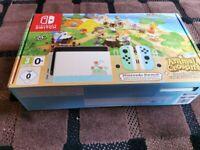 Nintendo Switch Animal Crossing Edition. 16GB MicroSD. 1 Year Membership.