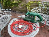 Old style Qualcast hedge trimmer.