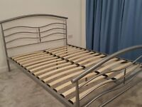 Metal standard double bed frame with slatted base and one matching bedside table, good condition