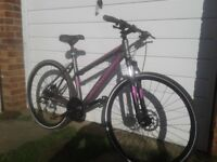 Kross ladies hybrid bike with disc brakes and front suspension