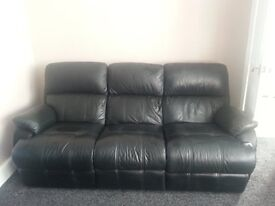 Black leather three-seater recliner sofa and two recliner chairs