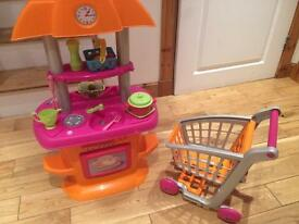 Kids kitchen, ironing board, tea-set