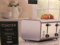 New Toaster. Tesco 4 slice silver. Boxed