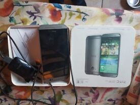 HTC ONE M8. Excellent condition and comes with box and original charger