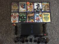 PS2 with Controllers and 10 Games *CAN CONSIDER OFFERS*