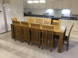 Solid Oak extendable dining table with 10 chairs. O.n.o