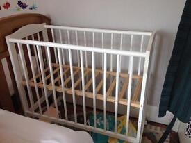 Bedside cot take one side off and slide next to bed