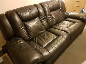Sofa and armchair (black leather recliners from DFS) for sale - £300 for both ONO. Collection only