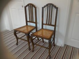 Two high back cane seated chairs